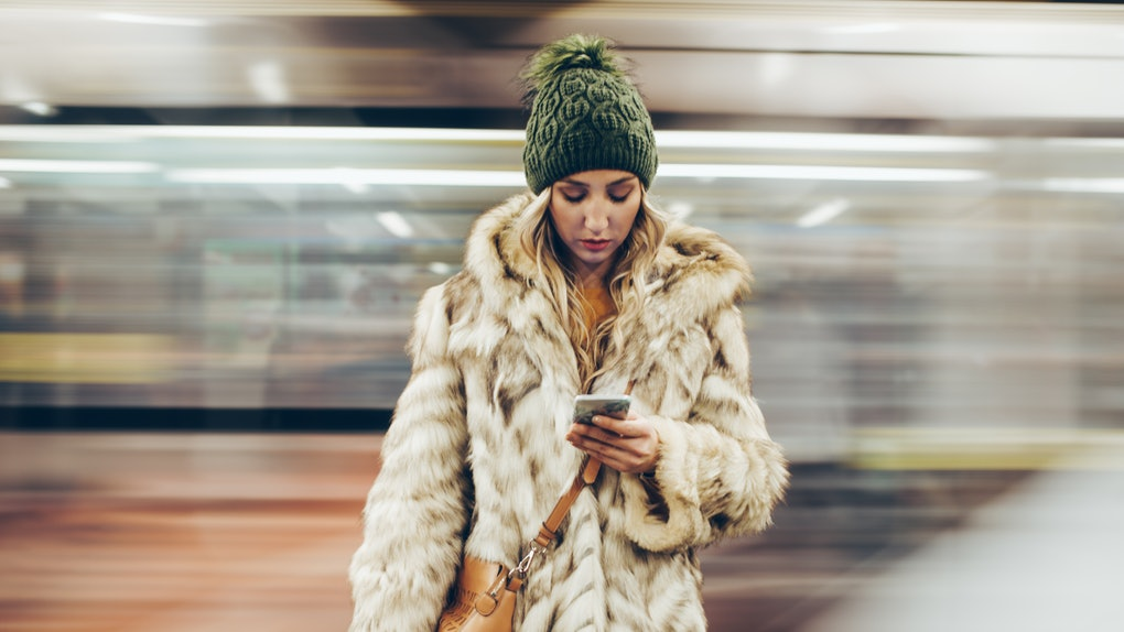 Young woman annoyed at train station on Thanksgiving