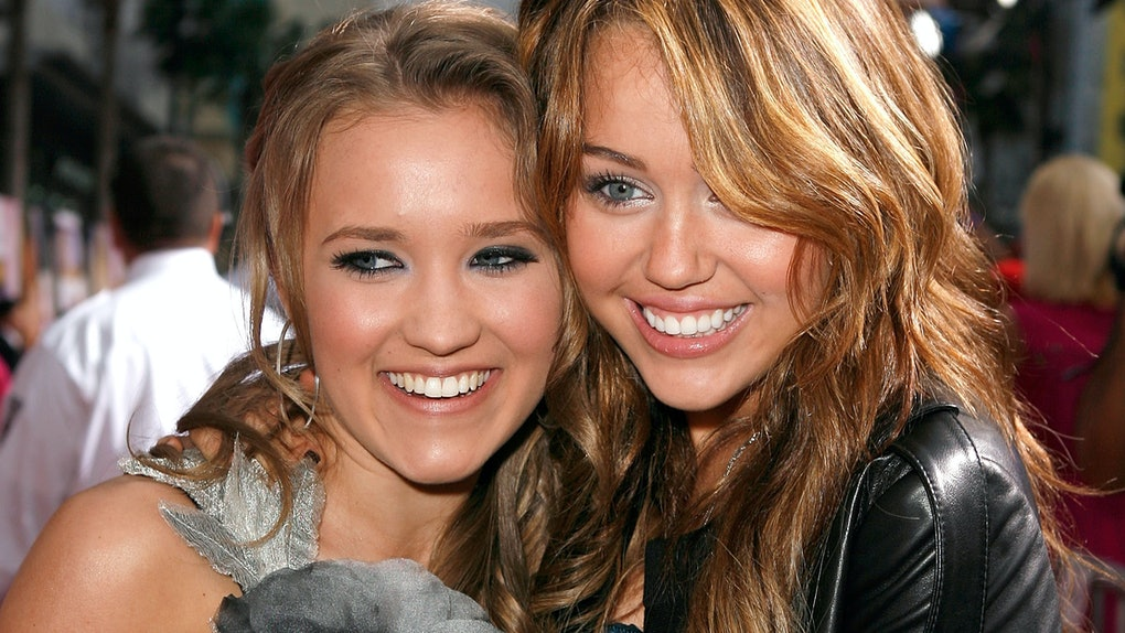 Miley Cyrus and Emily Osment hit the red carpet together.
