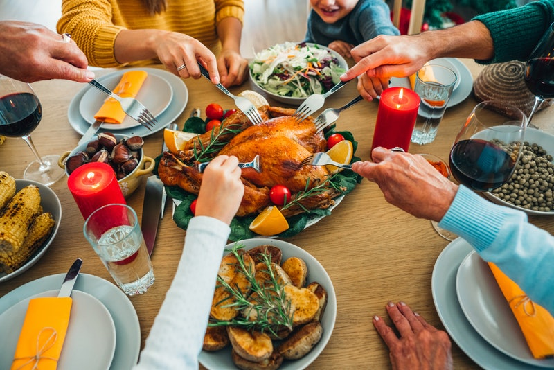A family tucks into a Thanksgiving turkey. Thanksgiving can be difficult for people who are sober, but there are ways to cope.