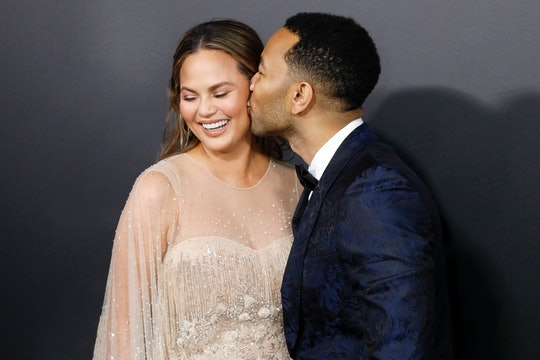 John Legend has said Chrissy Teigen's postpartum depression ultimately strengthened them as a couple.