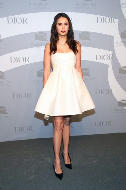 Nina Dobrev's Dior Beauty look and white Dior dress at the Guggenheim International Gala Pre-Party