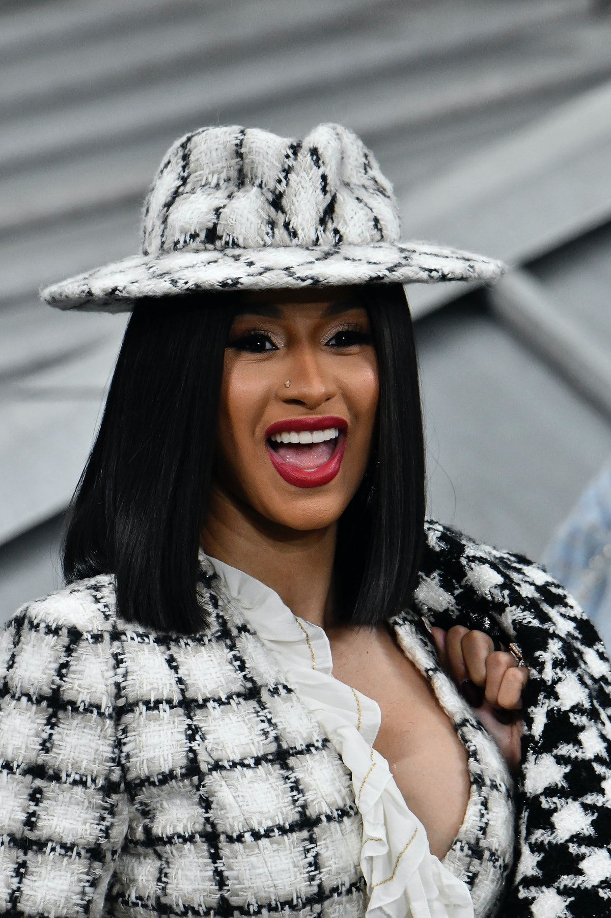 Cardi B steps out in a patterned black and white ensemble.
