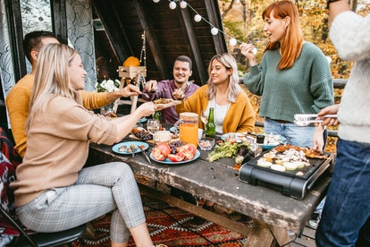 Friends eat a Thanksgiving meal outdoors. A sober Thanksgiving event can be great fun with the proper preparation, experts say.