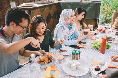 Friends celebrate Thanksgiving with a BBQ. A support network of friends can be helpful for people who need help to stay sober at Thanksgiving.