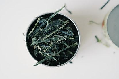 Sencha green tea leaves. Green and black tea have lower caffeine levels than coffee, and herbal tea has no caffeine.