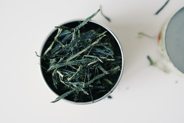 Sencha green tea leaves. Green and black tea have lower caffeine levels than coffee, and herbal tea has no caffeine.
