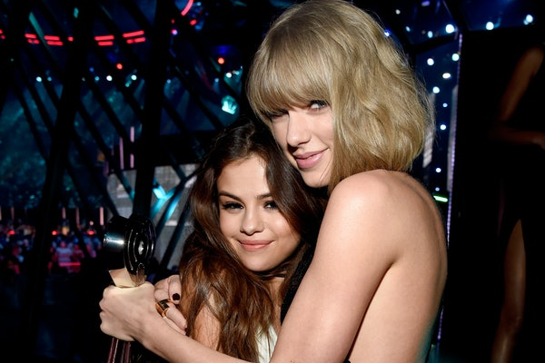 Selena Gomez and Taylor Swift pose for a photo.