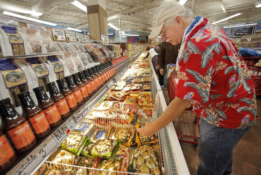 A man shopping the frozen food section at trader joe's