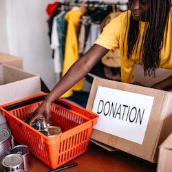 A woman organizes food bank donations during the Thanksgiving and Christmas season.