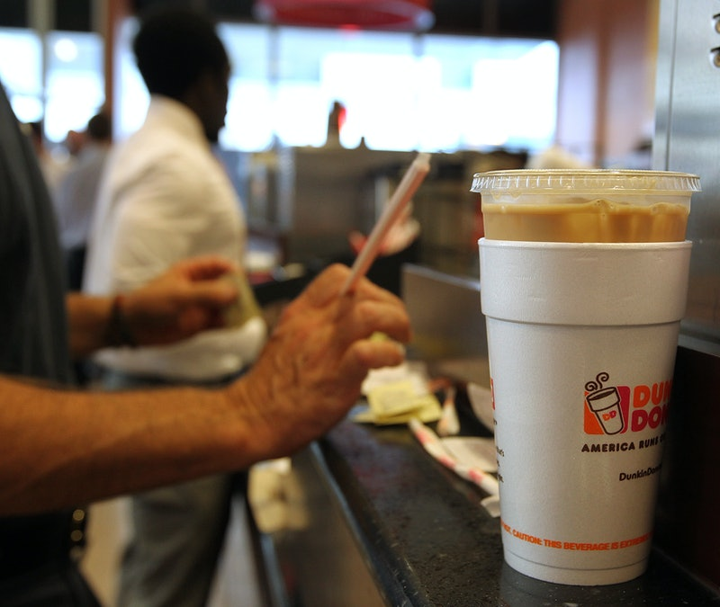 A classic Dunkin' foam cup with re-closeable lids. Dunkin' is now phasing out its foam cups in favor of more environmentally-friendly paper options.