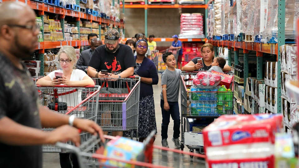 shoppers in a busy costco