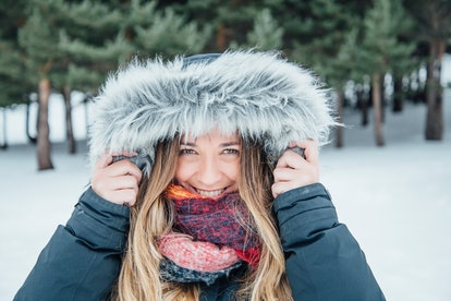 A woman protects her head from the snow. The brain is insulated by layers of bone and other materials so that it never feels the cold.