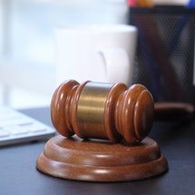 A judge's gavel on a desk. Jury duty can be traumatizing for jurors -- especially if they're survivors