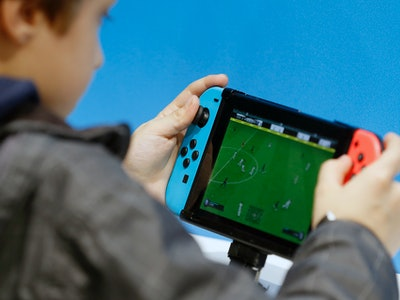a boy playing Nintendo switch