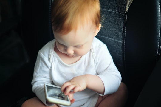 Your baby's love for your cell phone is partly because of how you interact with it, experts say.