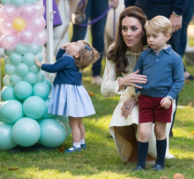 Princess Charlotte cannot get enough of the balloons at a party in British Columbia in September 2016.
