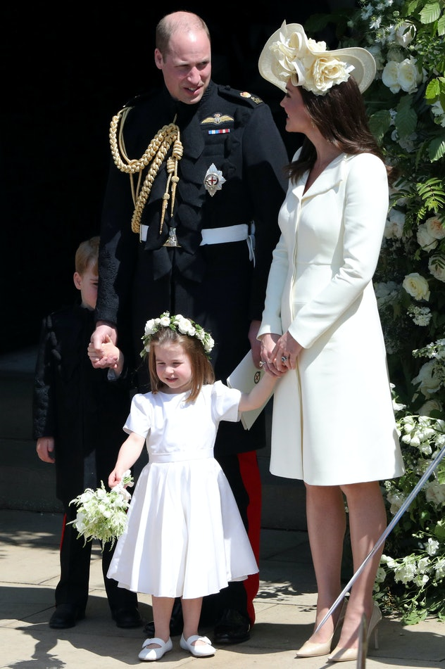 Prince George hides behind his dad while Princess Charlotte waves to the crowd at Meghan Markle's May 2018 wedding.