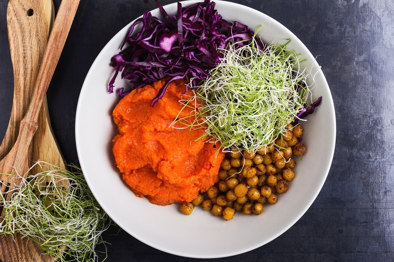 A colorful bowl of various vegan Thanksgiving foods. Your first vegan Thanksgiving can be tough, but you can get through it with wit and grace.
