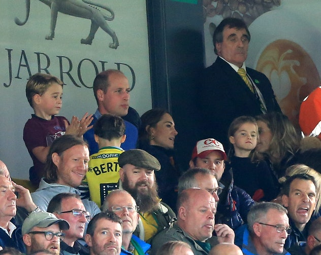 Prince George got excited at a football match while Princess Charlotte was more reserved.