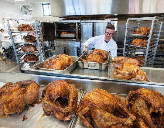 A chef preparing Thanksgiving turkeys at a shelter