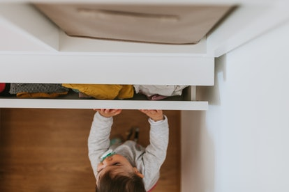 Experts say drawers are basically giant boxes to babies, and they love taking things out and putting things in.