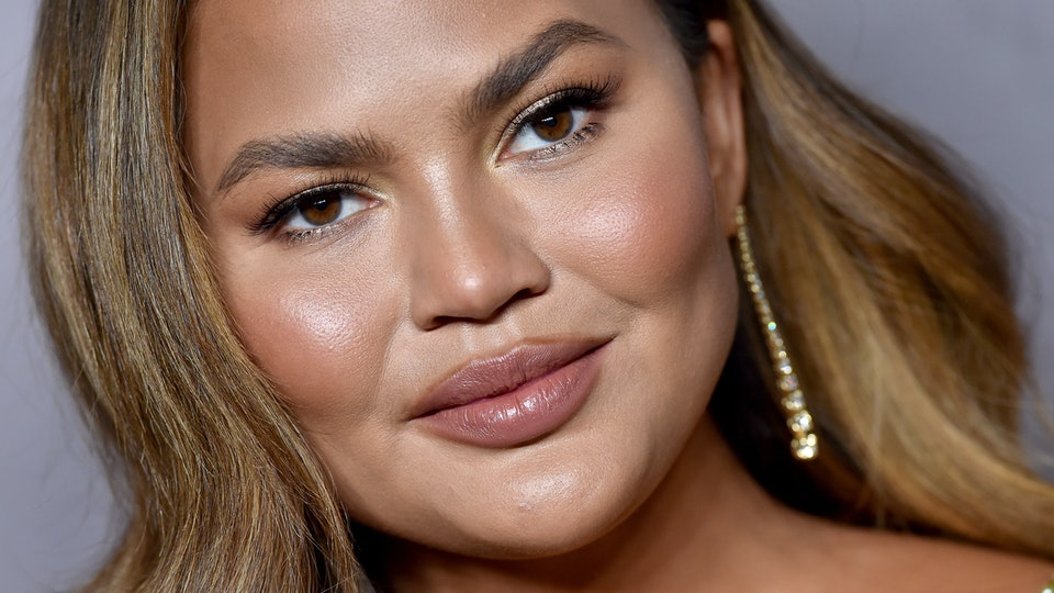 Chrissy Teigen eats Thanksgiving dinner the day after.