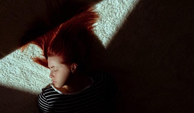 A woman naps in sunshine. Professional help from sleep laboratories and cognitive behavioral therapists can help insomniacs get a better night's sleep.