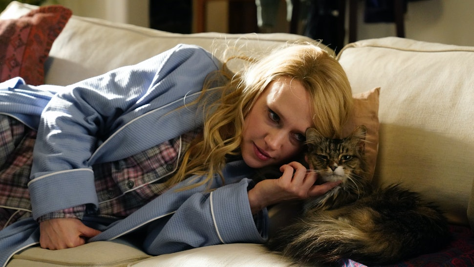 Kate McKinnon pets a cat during a Saturday Night Live sketch