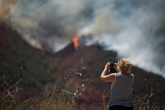 woman taking a picture of the California wildfires