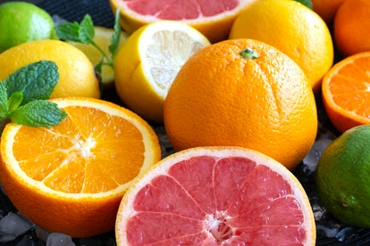 Citrus fruits including oranges and grapefruit are shown on ice. Sources of vitamin C including citrus fruit can help the immune system function.