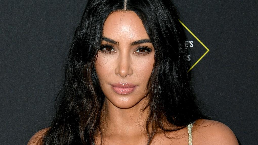Kim Kardashian hits the red carpet in a snakeskin dress.