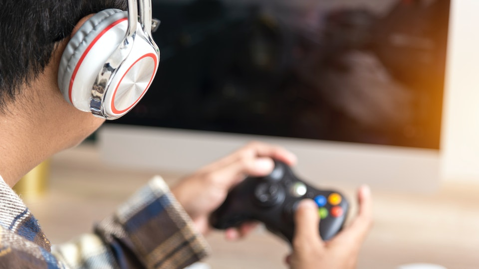 If your husband plays video games instead of helping with the baby, experts say honest communication is key.