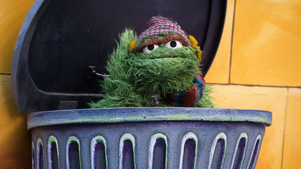 Oscar the grouch in his trash can
