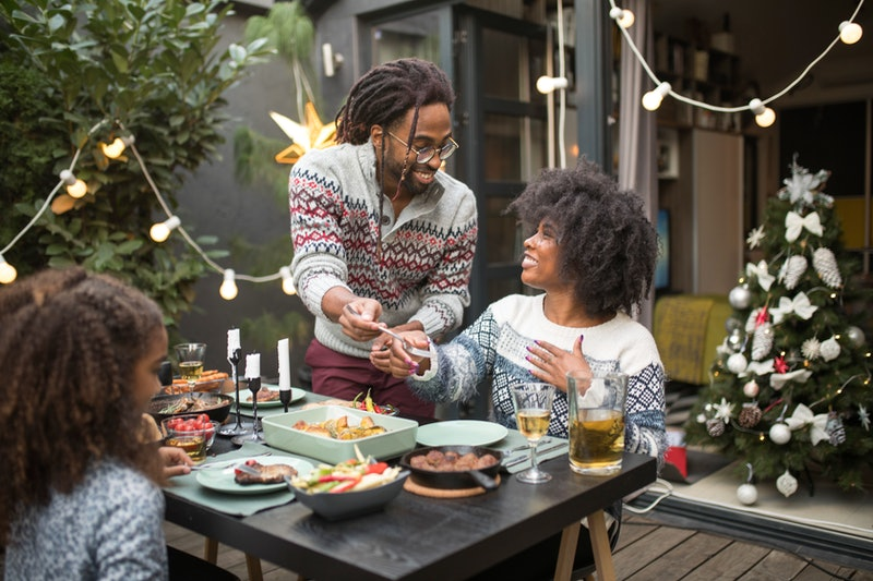 A family has a holiday dinner outside. Nosy relatives are always going to ask invasive questions, so we asked an expert how to deal with them.