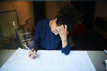 A woman looks tired at work. Burnout can cause physical changes in the structure of the brain, including enlarging the amygdala.