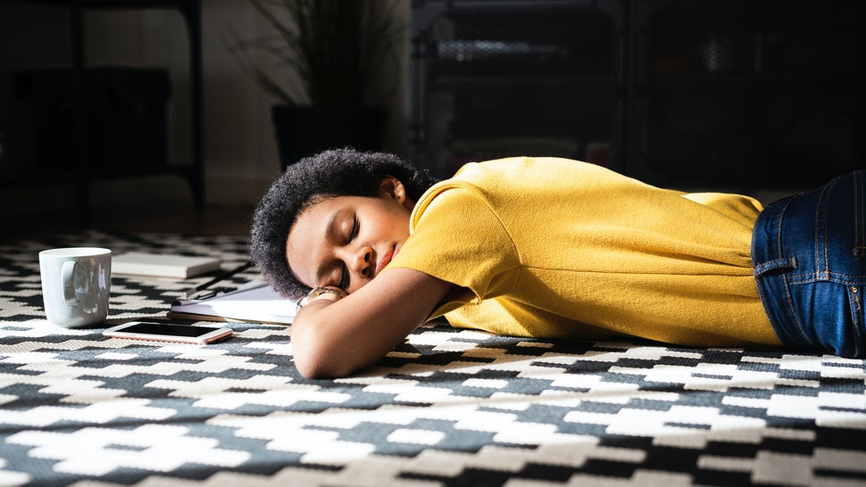 A woman lies on the floor. Signs you have low estrogen can range from the expected to the surprising.