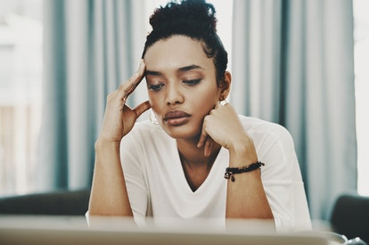 A woman looks tired at work. Burnout can thin the prefrontal cortex, impairing decision-making, memory and attention.