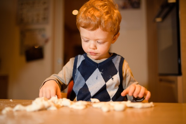 Playing with dough can help keep your toddler busy while cooking.