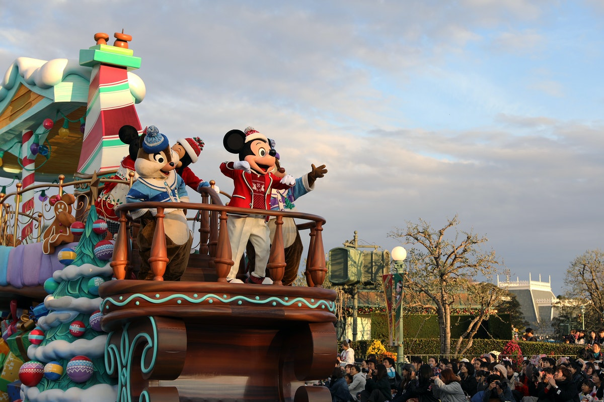 Mickey Mouse and other Disney characters pose on float in Magic Kingdom during a Christmas celebrati...