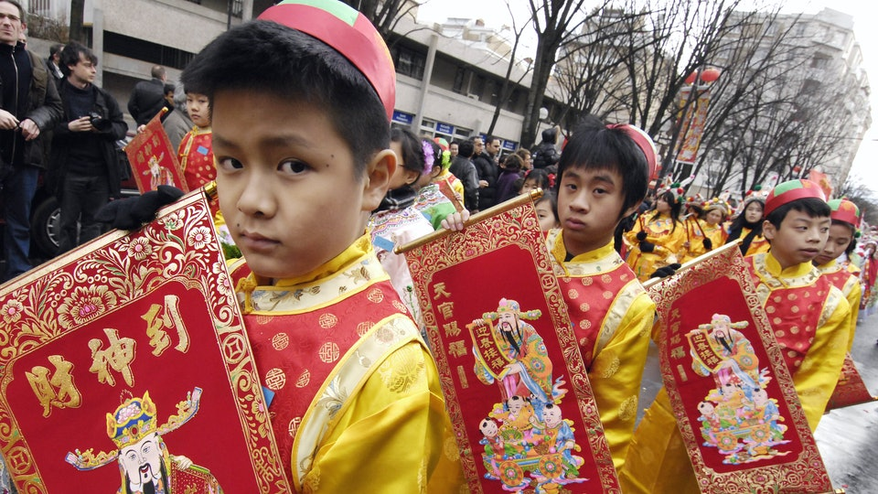 kids lined up in a Chinese new year parade