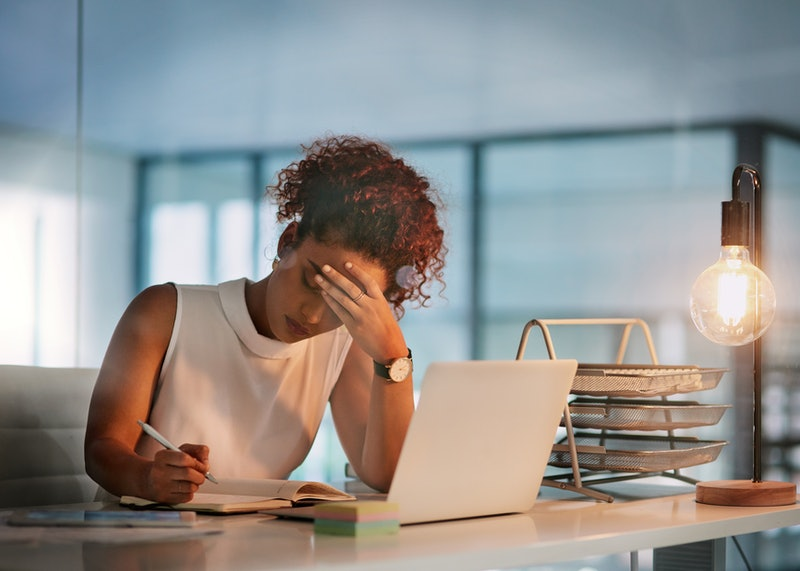 A woman sits at a desk doing work. A new report says it'll take another 257 years to close the gender pay gap globally.