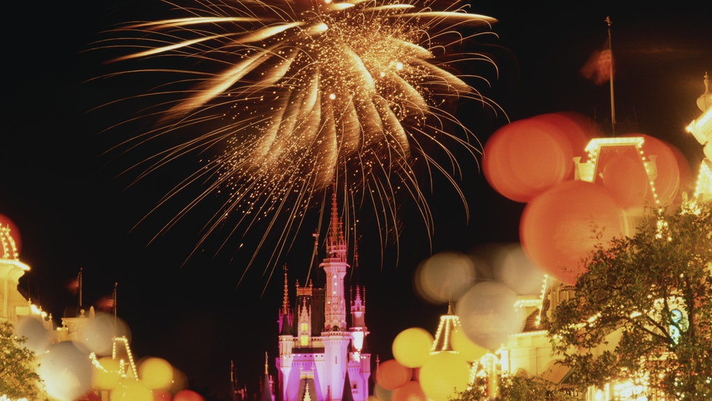 Fireworks and Mickey Mouse-shaped balloons light up the night sky on New Year's Eve at Disney World.