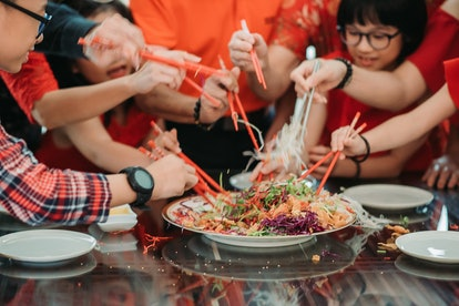 a family sharing a meal on lunar new year