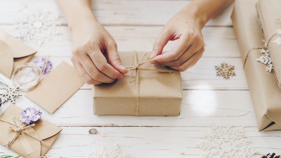 A woman wraps gifts for the holidays. Holiday food can trigger diet and exercise talk, but it doesn't have to be the focus of the holiday season.