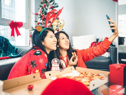 Two women take a selfie at a holiday party. If you're feeling uncomfortable with a discussion of body weight or image at a party, experts say you should just walk away.