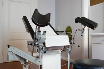 An exam chair at a gynecologist's office. Cervical dysplasia is one possible reason for post-coital bleeding.