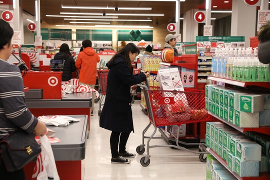 a woman standing in line at target