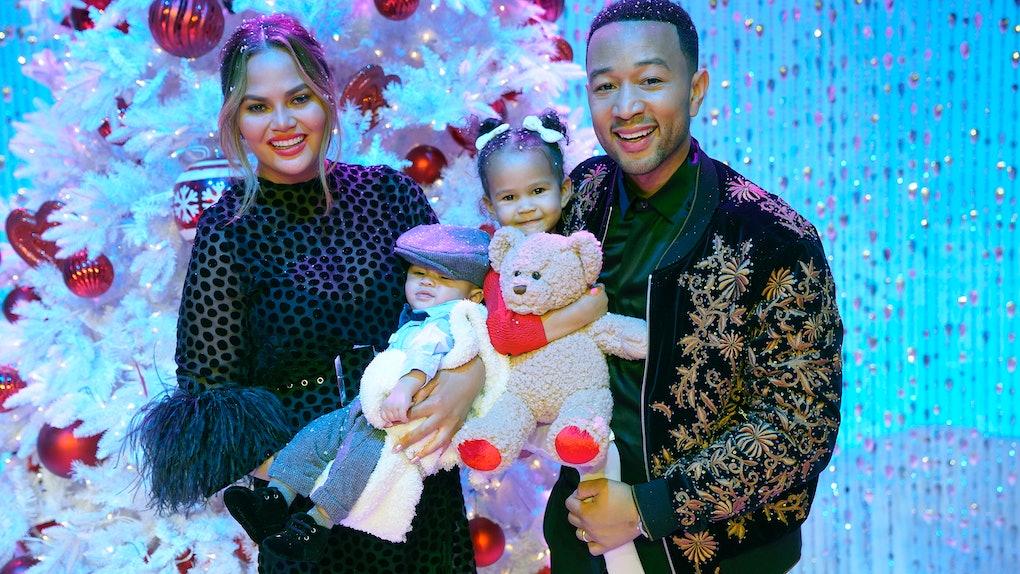 Chrissy Teigen, John Legend, and their kids pose for a snapshot.