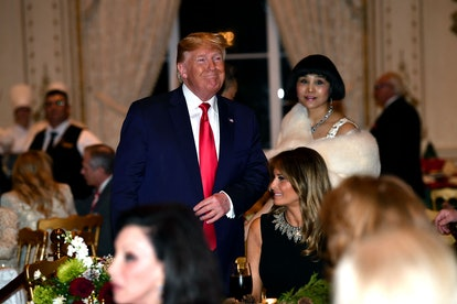 President Donald Trump and First Lady Melania Trump attend a Christmas dinner at the president's Mar-a-Lago resort.