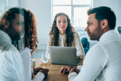 A couple mediate their divorce with a lawyer. Divorce can ultimately be more painful than a breakup because of the legal complications and stress.